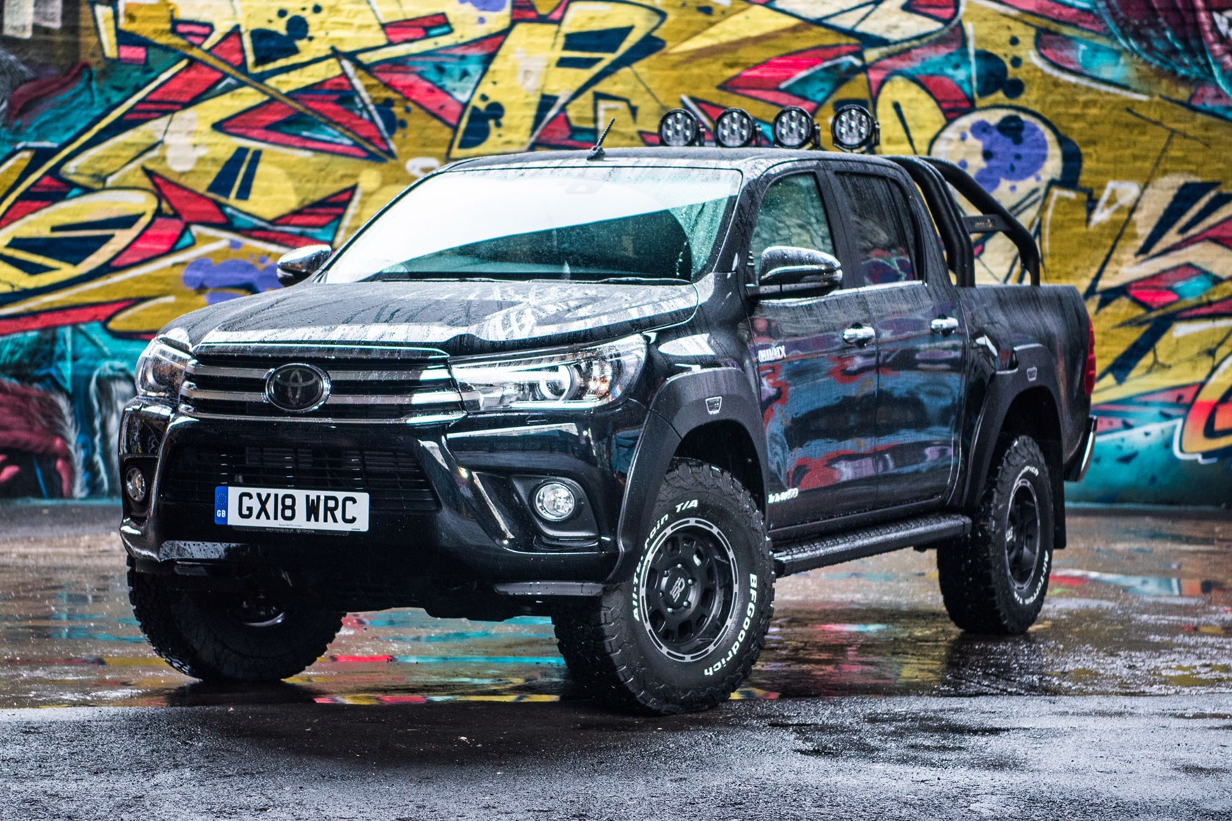 Toyota Hilux Invincible 50 review - front view, black, in the rain