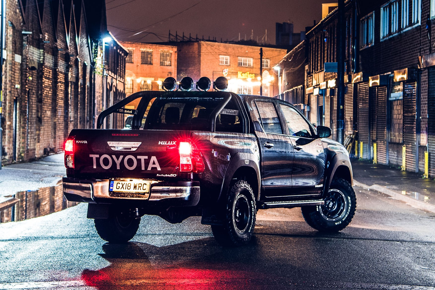 Toyota Hilux Invincible 50 review - rear view, black, at night