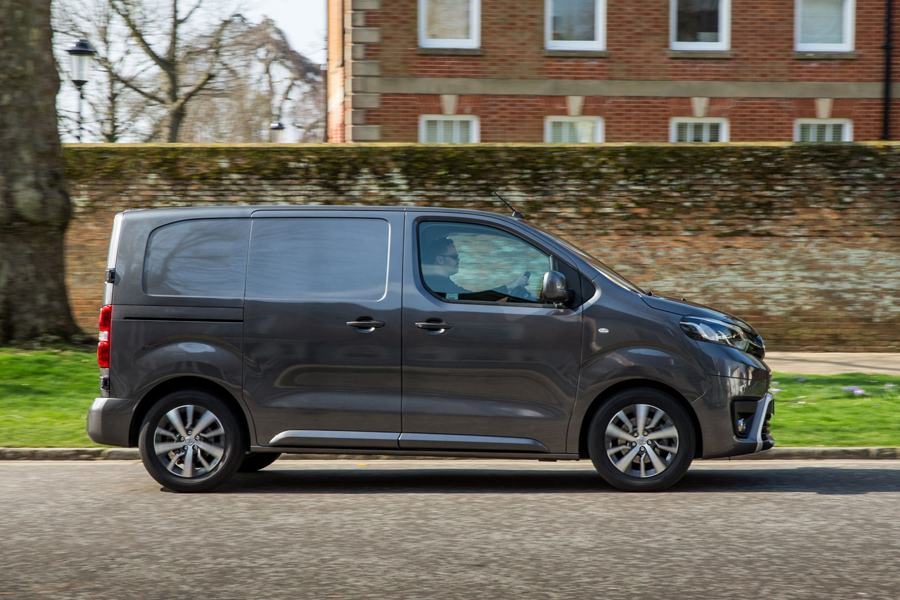 Toyota Proace review - Compact model, side view, driving, grey, 2018