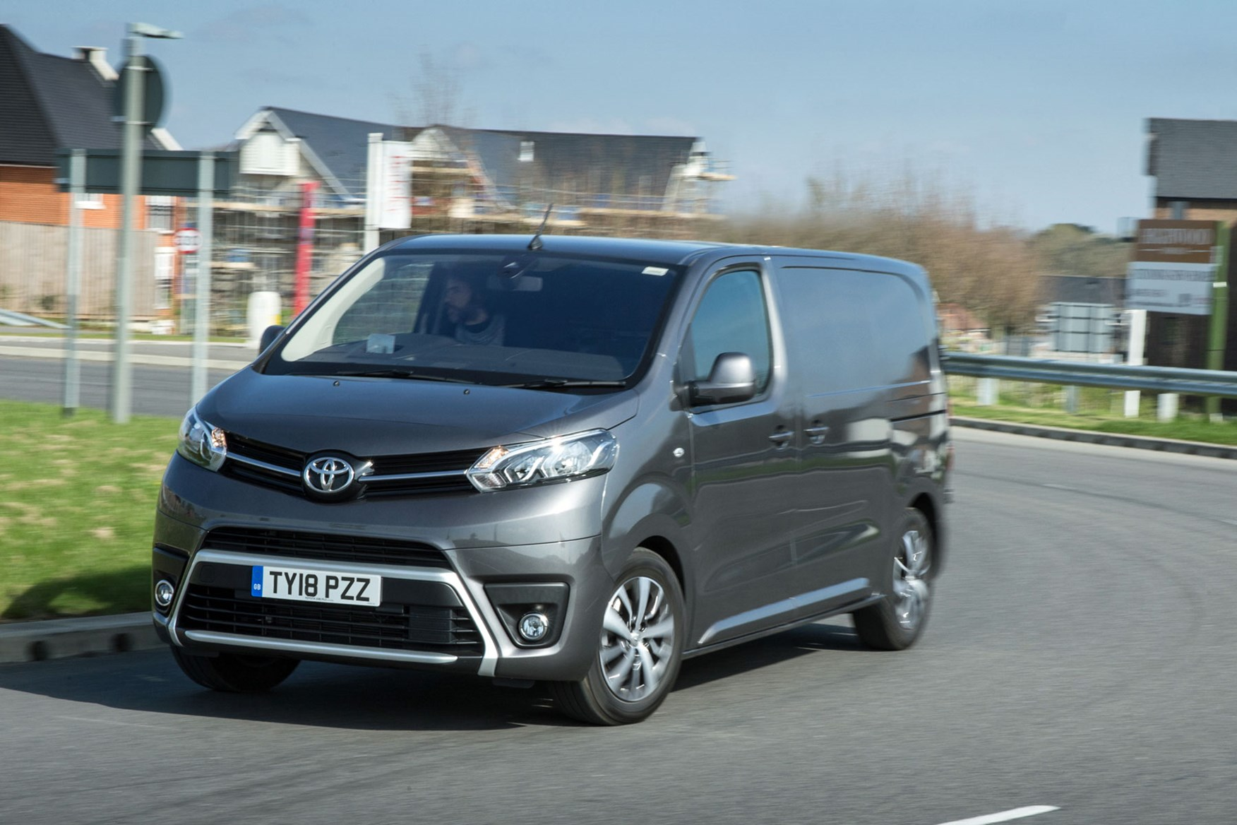 Toyota Proace review - Medium model, front view, driving round corner, grey, 2018
