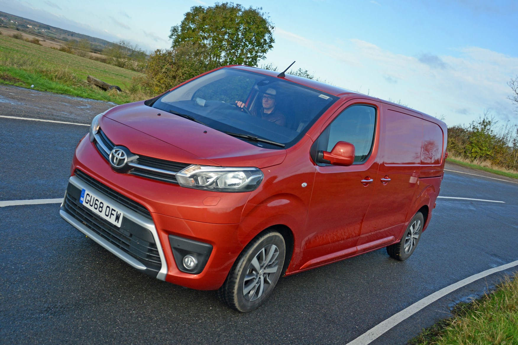 Toyota Proace automatic review - front view, orange, driving round corner, 2019