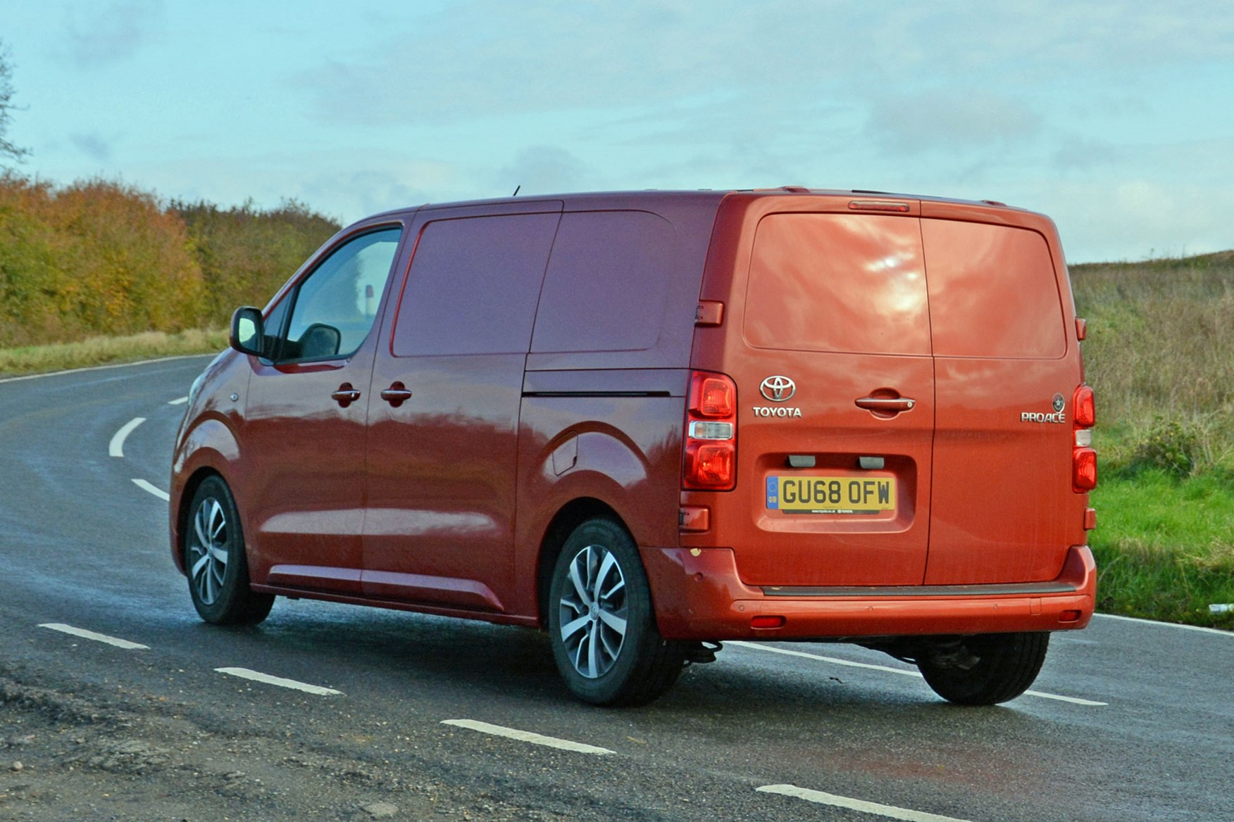 Toyota Proace automatic review - rear side view, driving round corner, orange, 2019