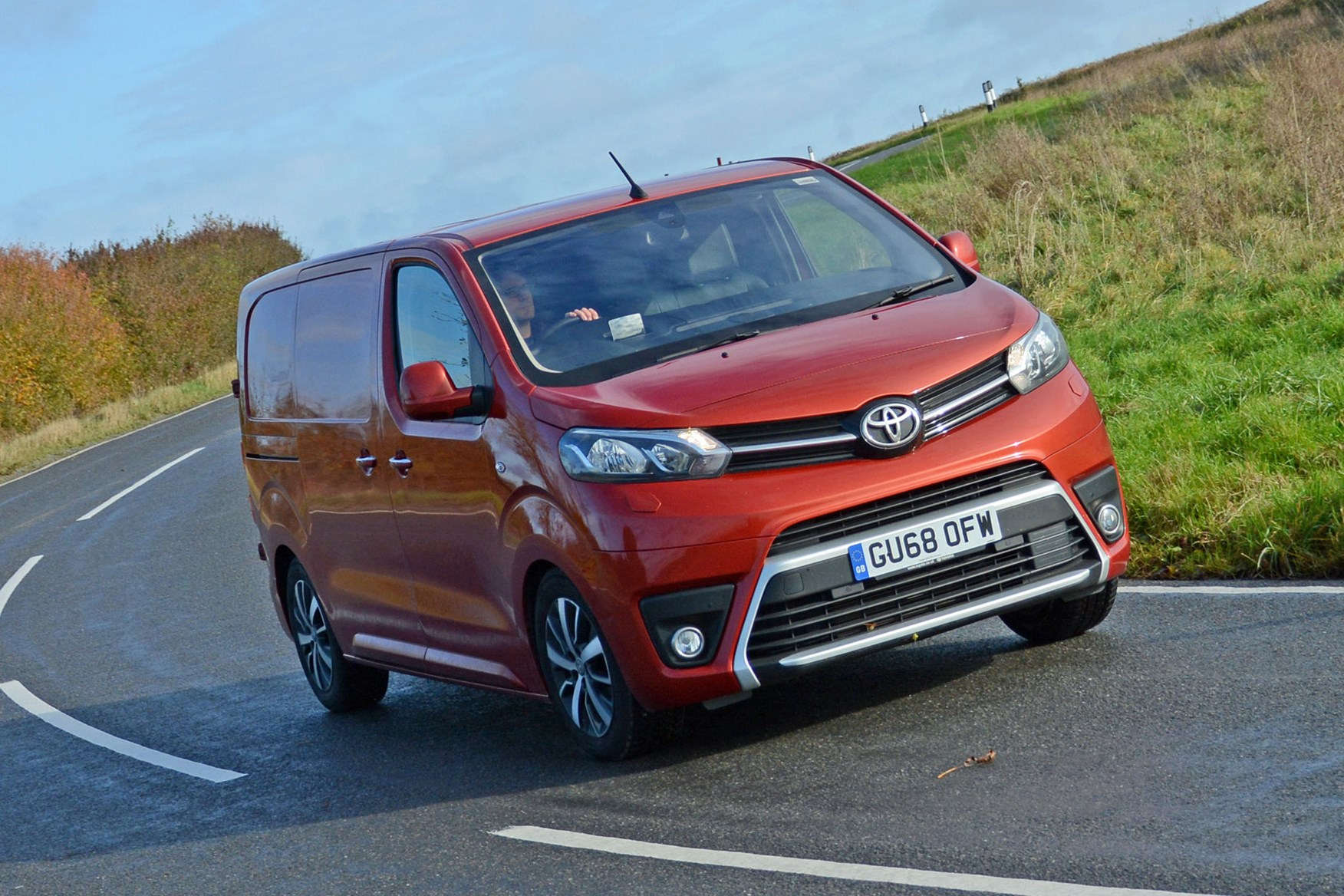 Toyota Proace automatic review - front view, driving round corner, orange, 2019