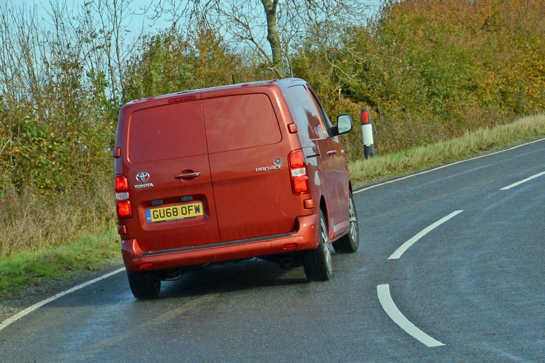 Toyota Proace automatic review - rear view, driving round corner, orange, 2019