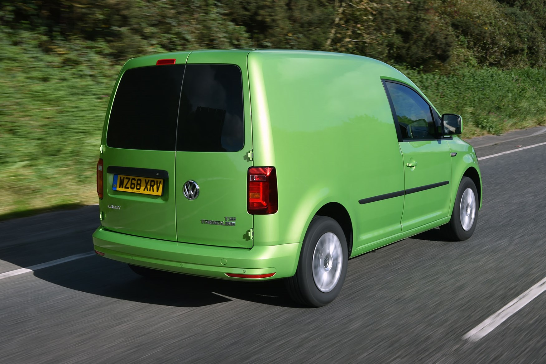 VW Caddy review - 2018 model, rear view, driving, green
