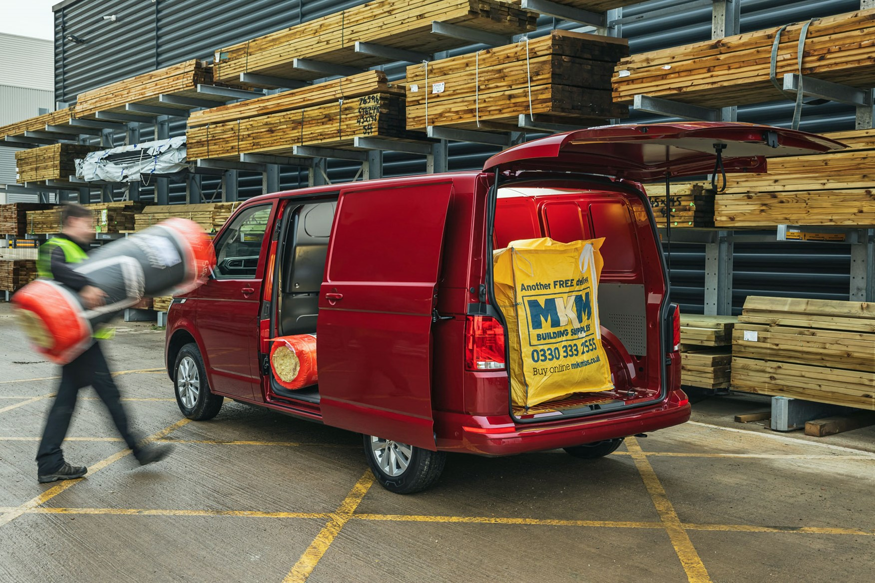 Volkswagen Transporter review, T6.1, 2020, red, rear view, van being loaded