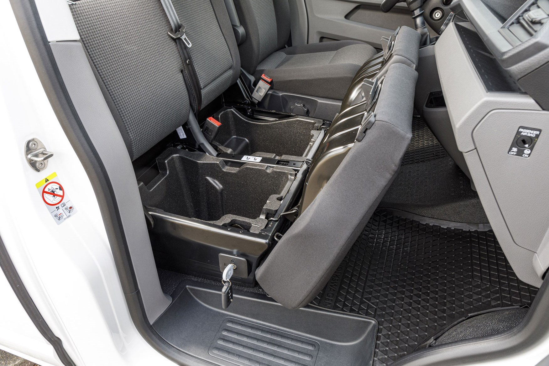 VW Transporter review - T6.1 2019 facelift, cab interior showing lockable under-seat storage