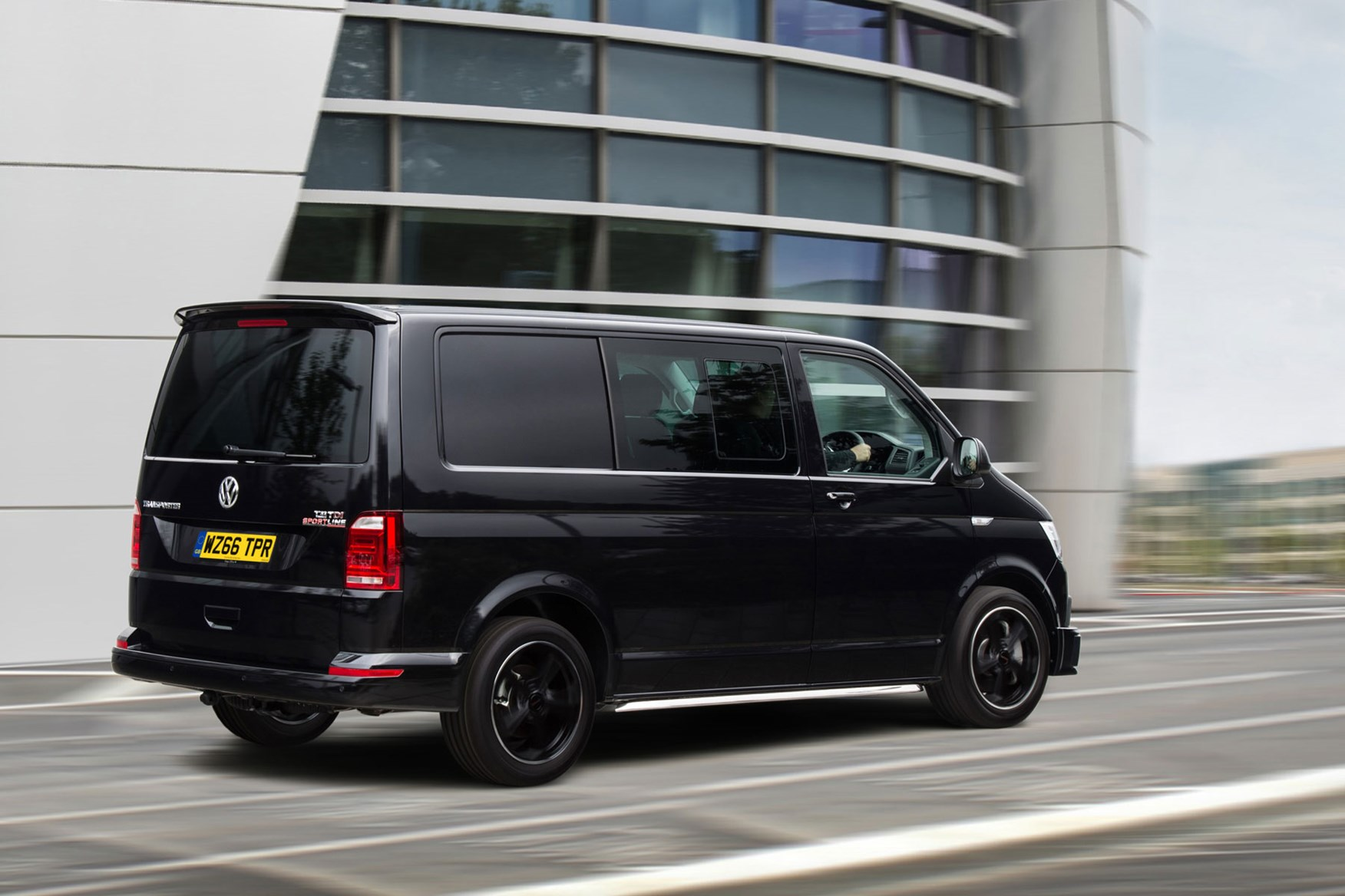VW Transporter T6 Sportline review - kombi, black, rear view driving