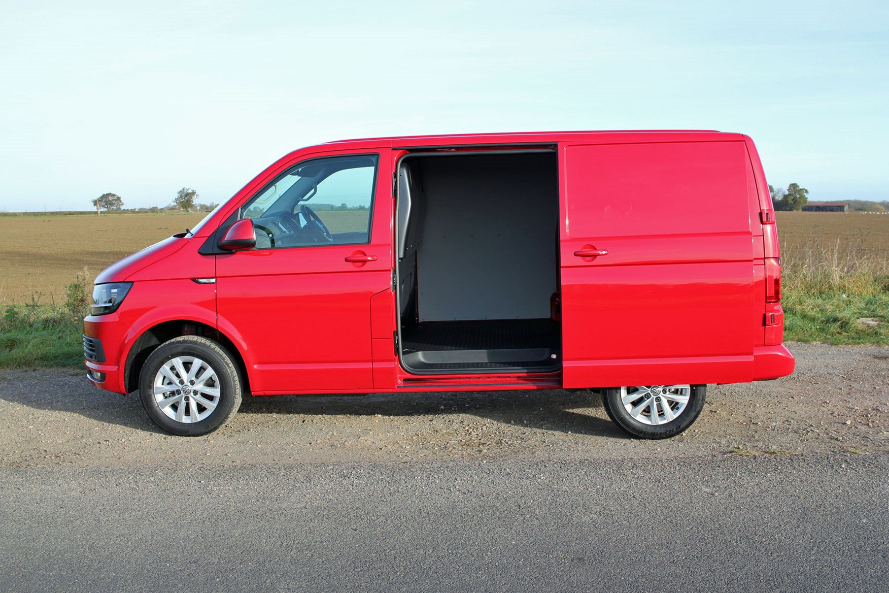 VW Transporter T6 TSI 150 review - side view, sliding door open, red