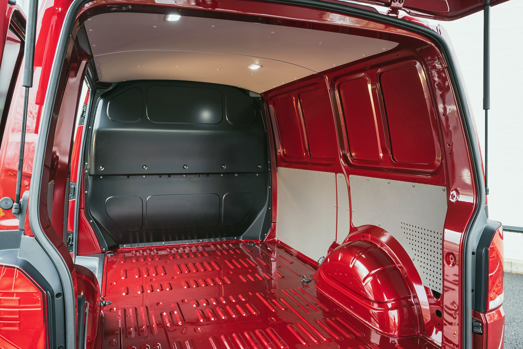 VW Transporter T6.1 load area, view from rear doors, red, 2020