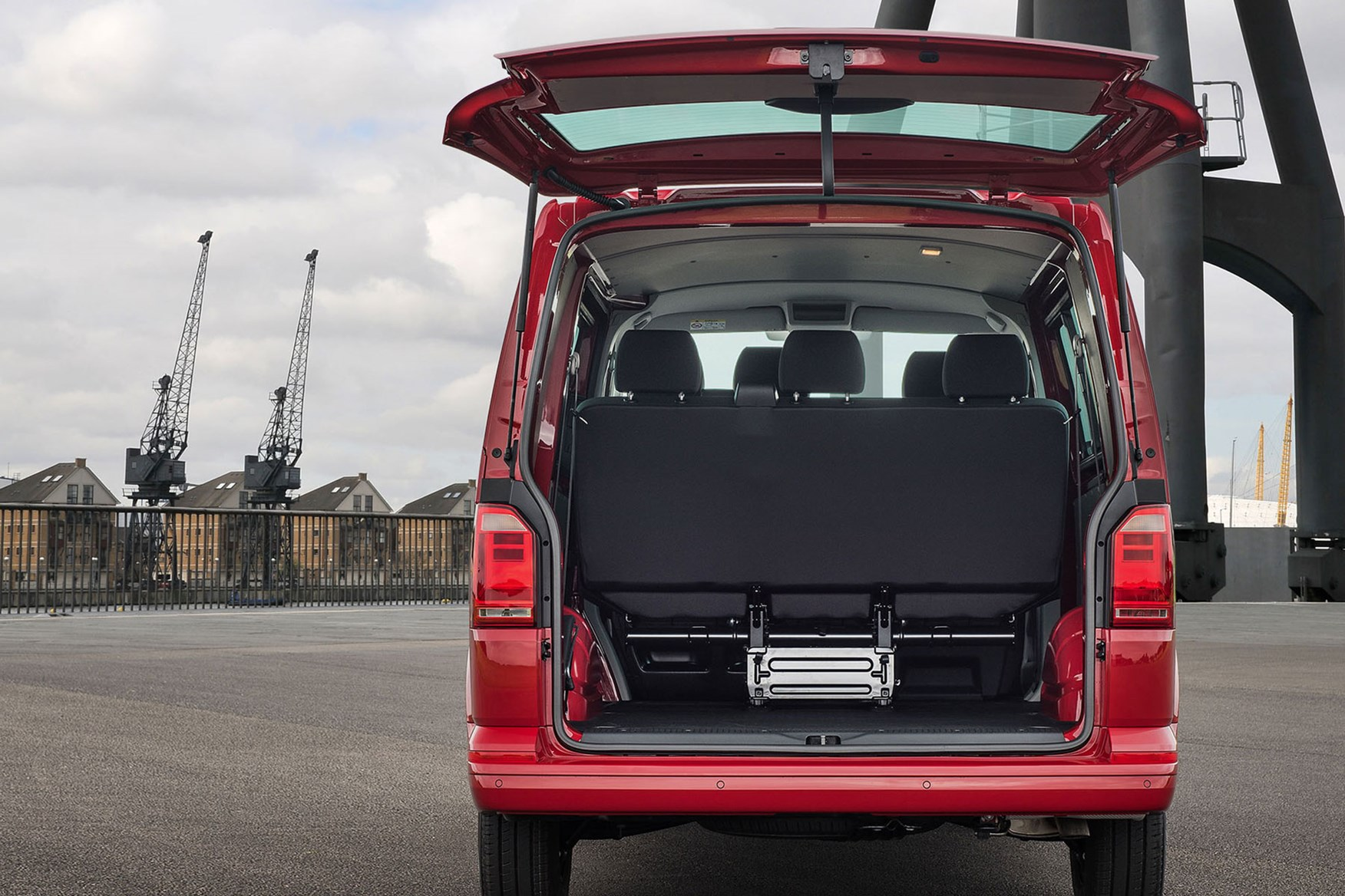VW Transporter T6 kombi load area with rear seats in place, tailgate, red