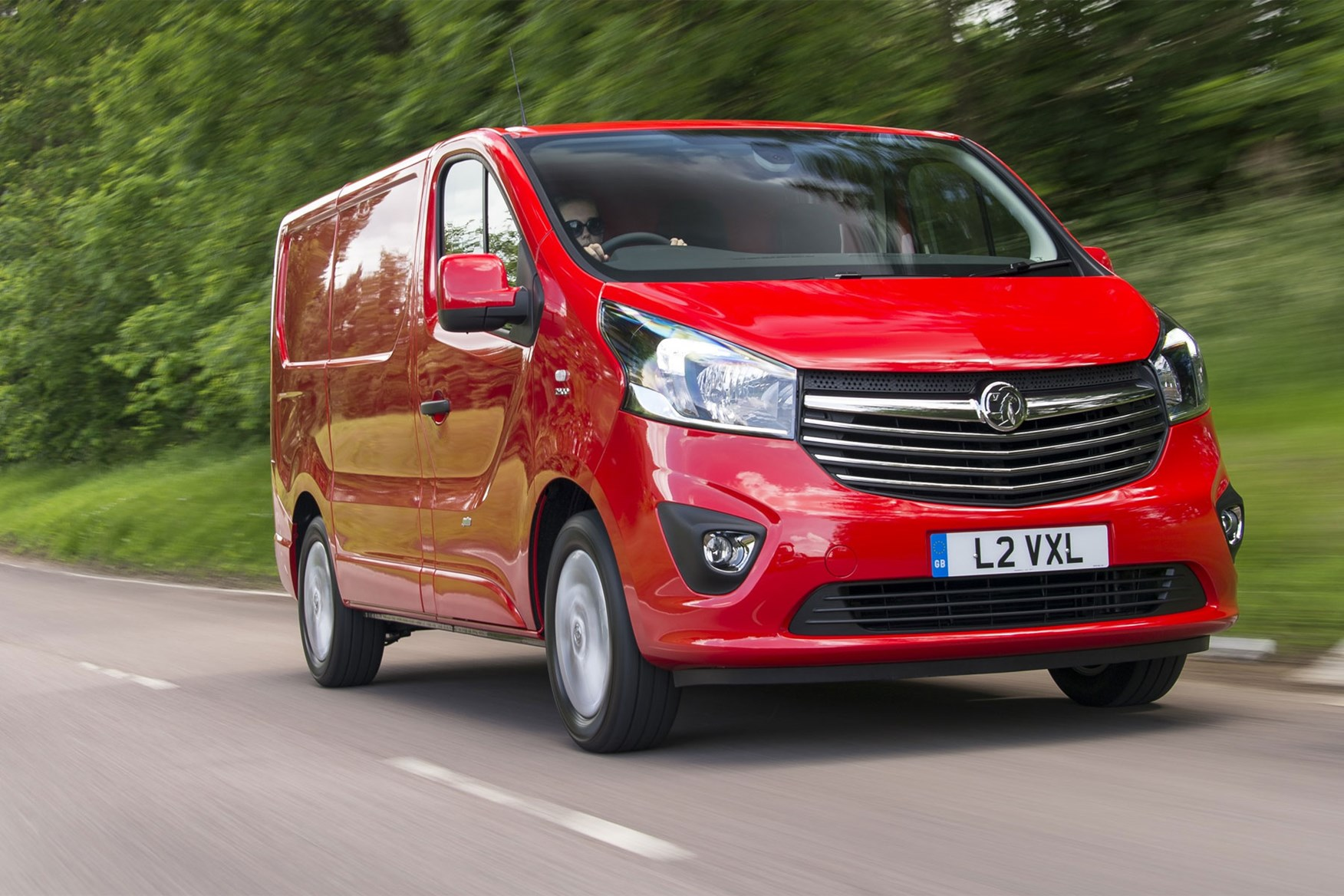 Vauxhall Vivaro review - front view, red, driving