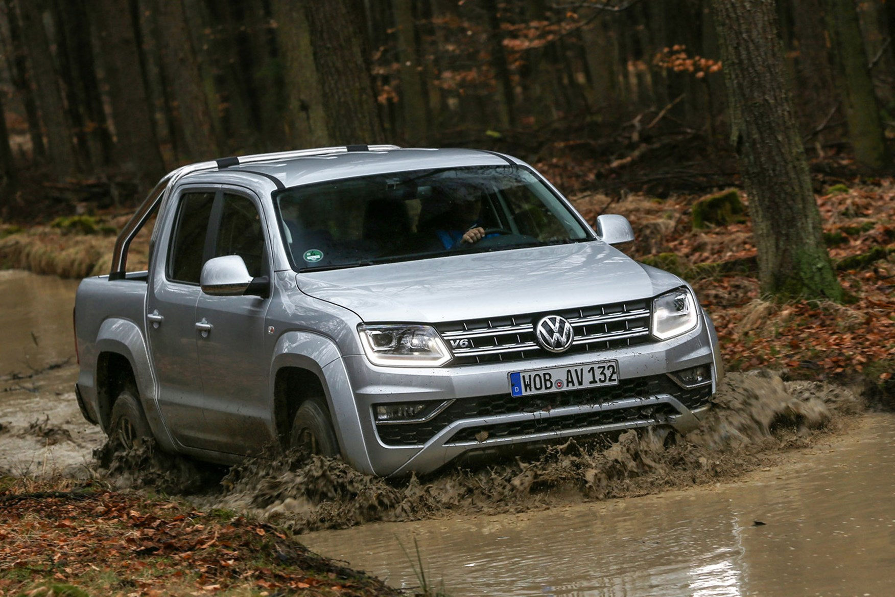 VW Amarok V6 Trendline 204hp review - front view, driving through muddy river, silver