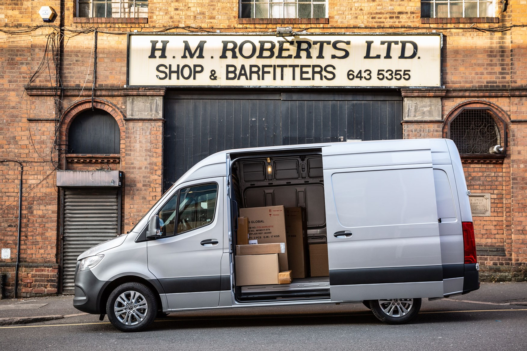 Mercedes Sprinter (2018-on), side view, door open with boxes inside