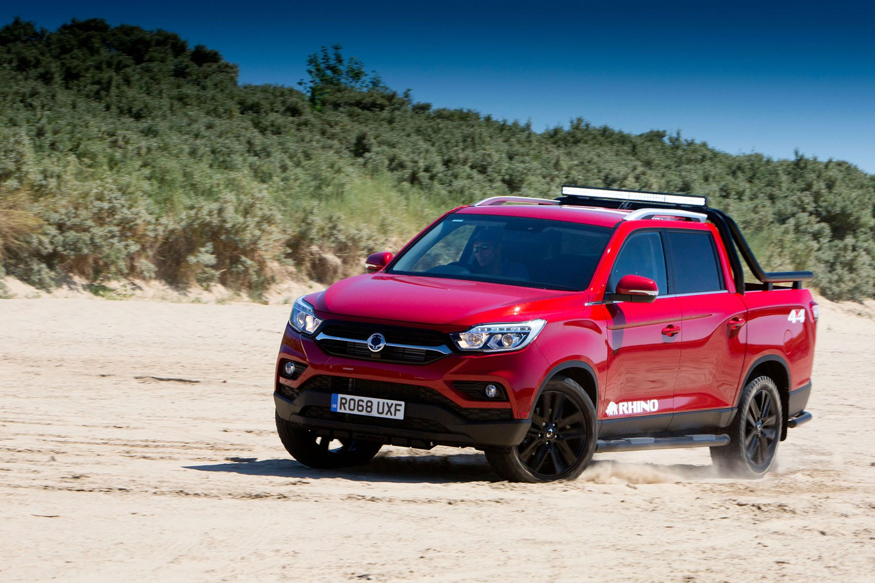 SsangYong Musso (2018-on) review, Rhino, front view, red, driving on sand
