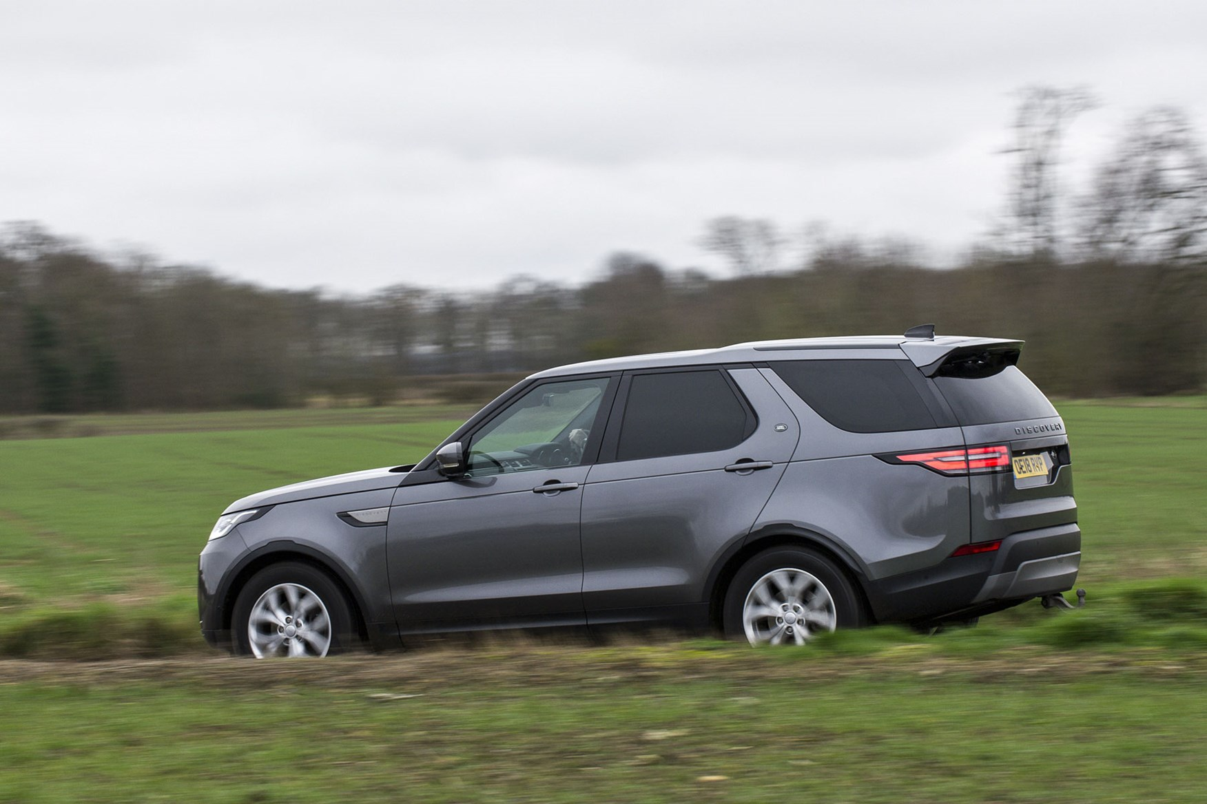Land Rover Discovery Commercial review (2020), rear side view, driving