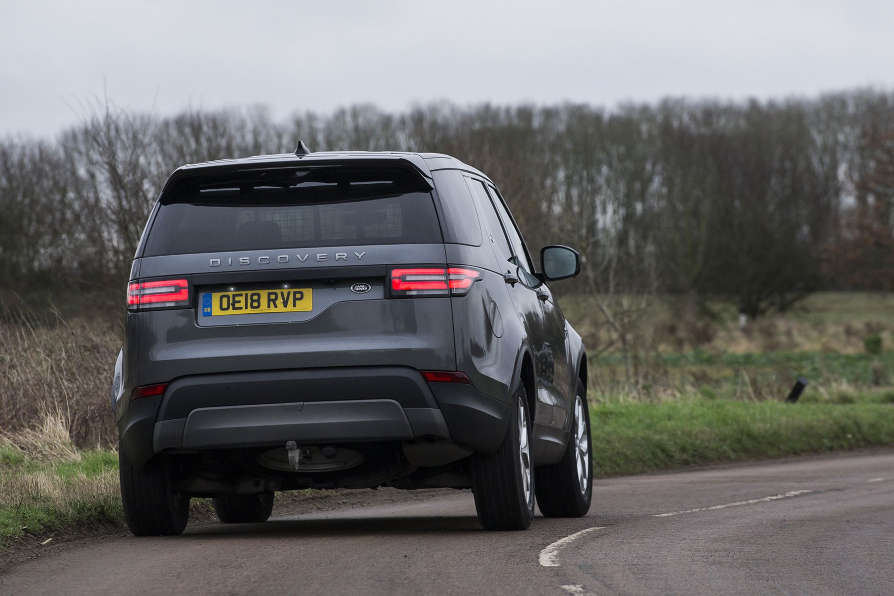 Land Rover Discovery Commercial review (2020), rear view, driving