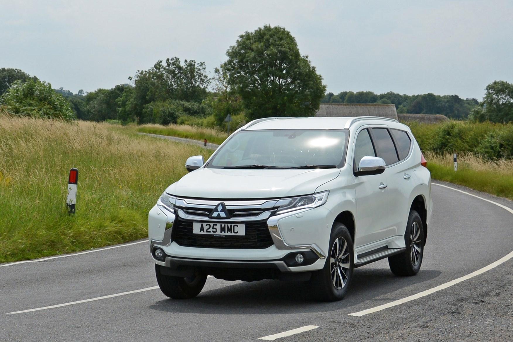 Mitsubishi Shogun Sport Commercial 4x4 van review - front view, white, driving round corner