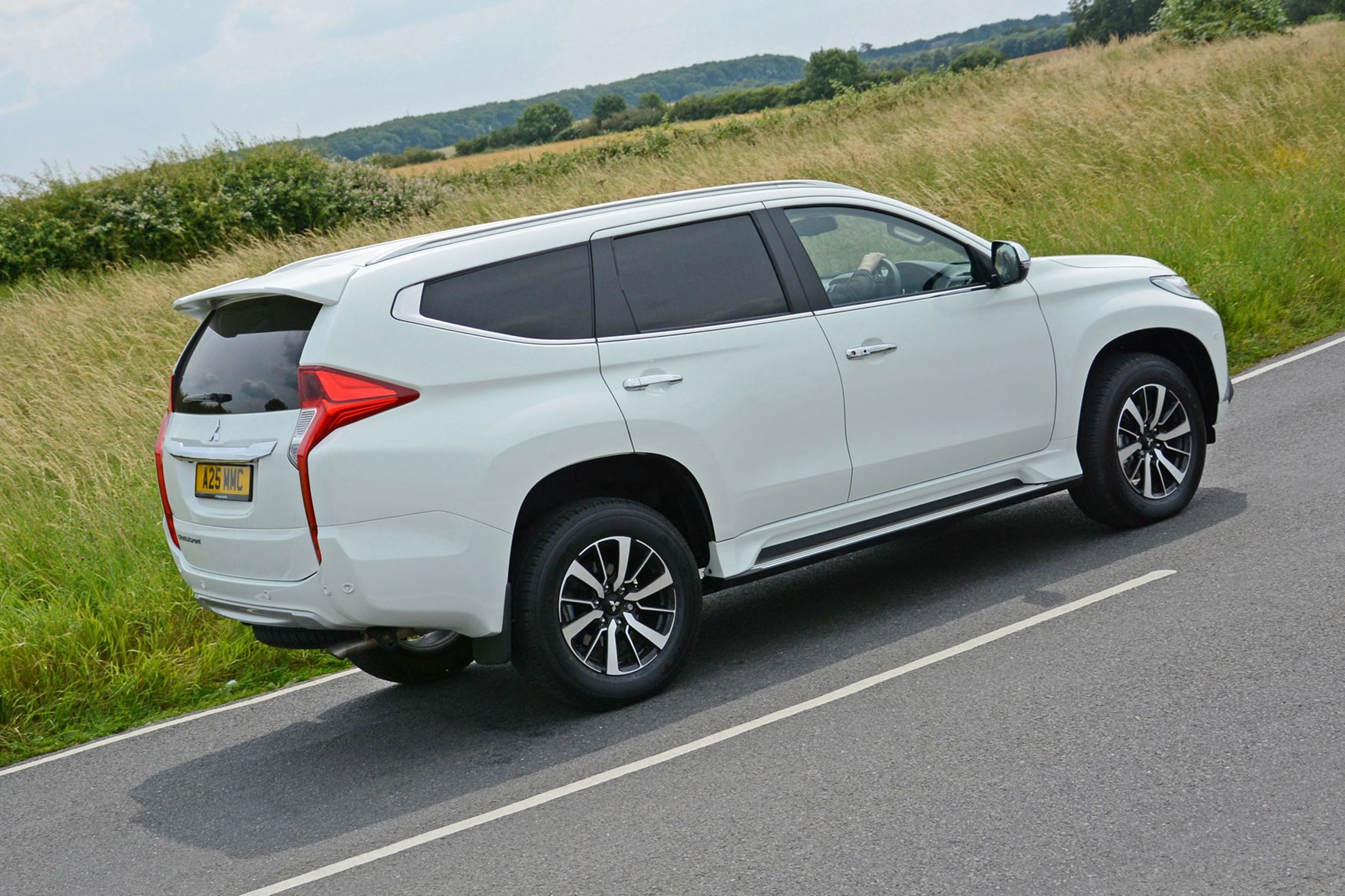 Mitsubishi Outlander Commercial 4x4 van review - rear view, white, driving