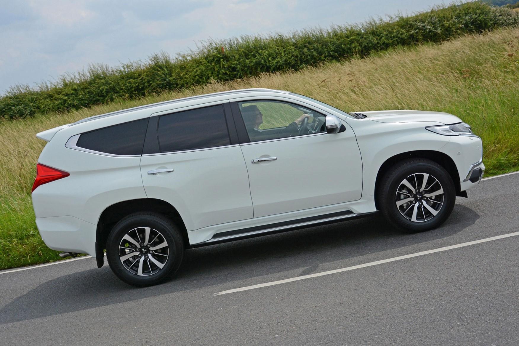 Mitsubishi Shogun Sport Commercial 4x4 van review - side view, white, driving