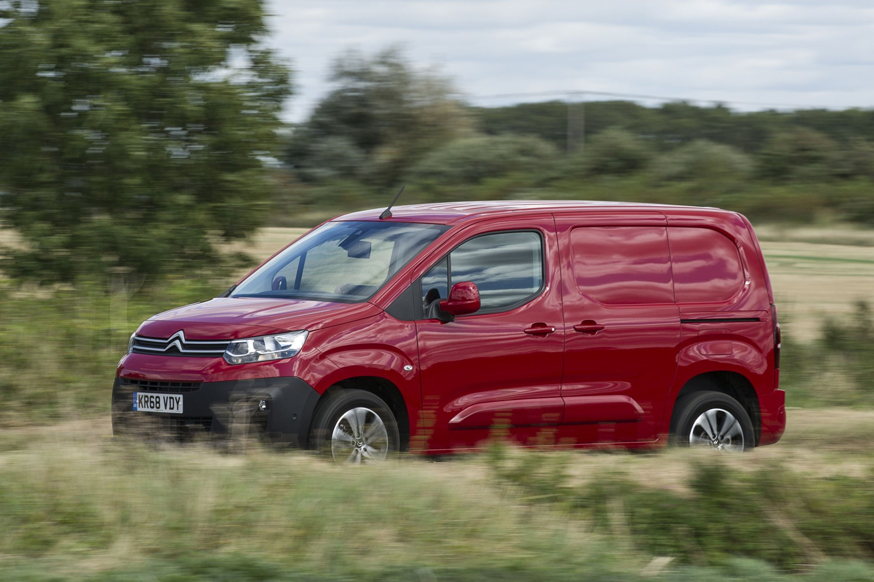 Citroen Berlingo van review - 2019 model, side view, red, driving