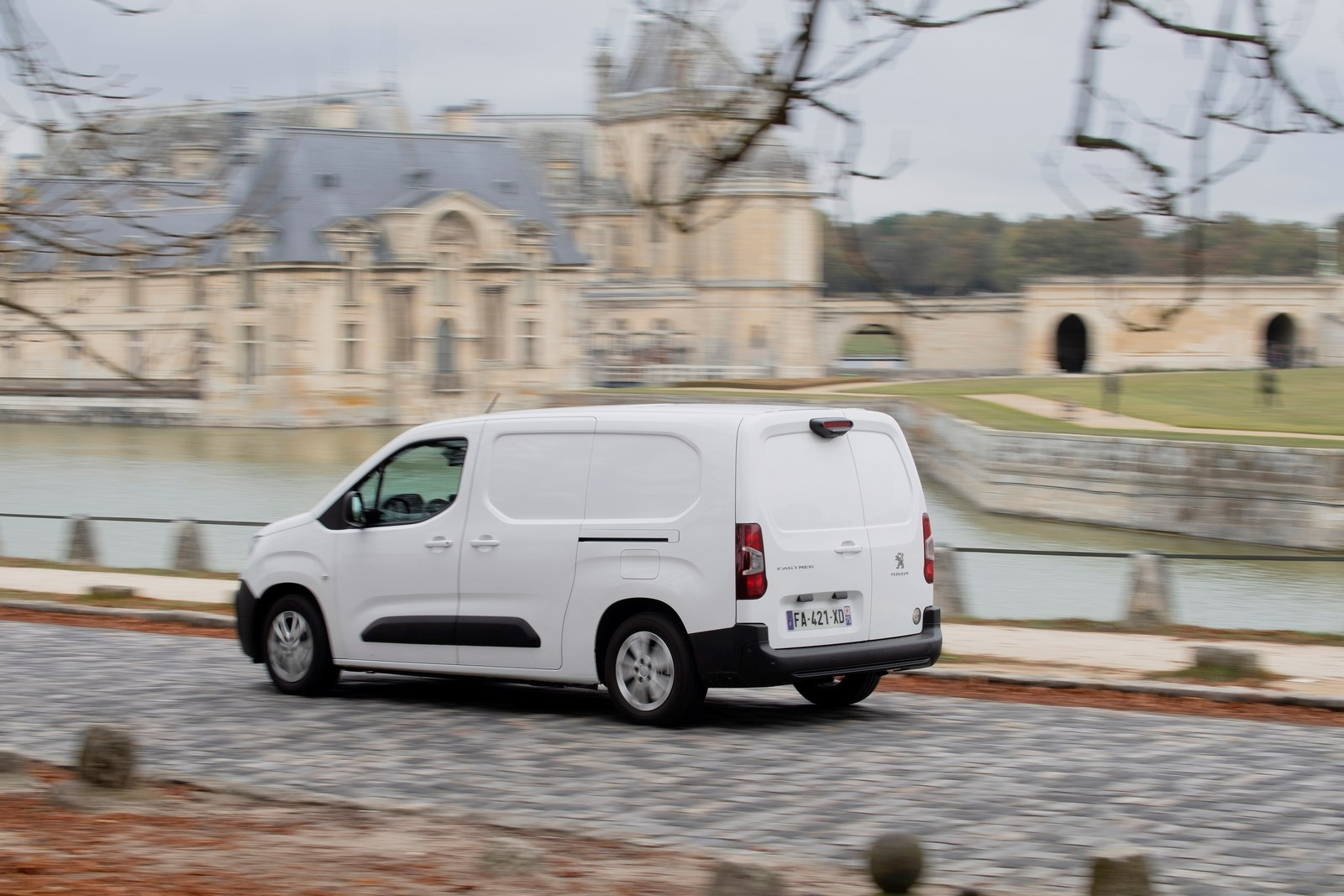 Peugeot Partner review 2020, rear view, driving