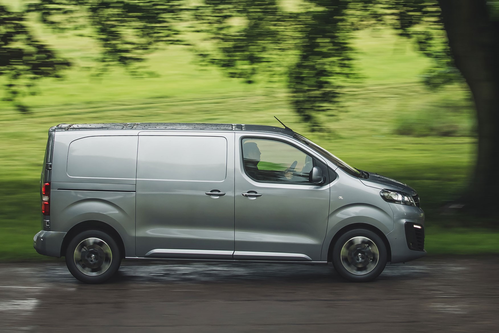 Vauxhall Vivaro review - side view, silver, driving in the rain