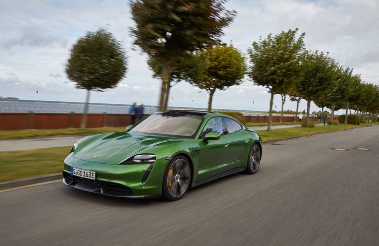 Green 2020 Porsche Taycan front threequarters tracking