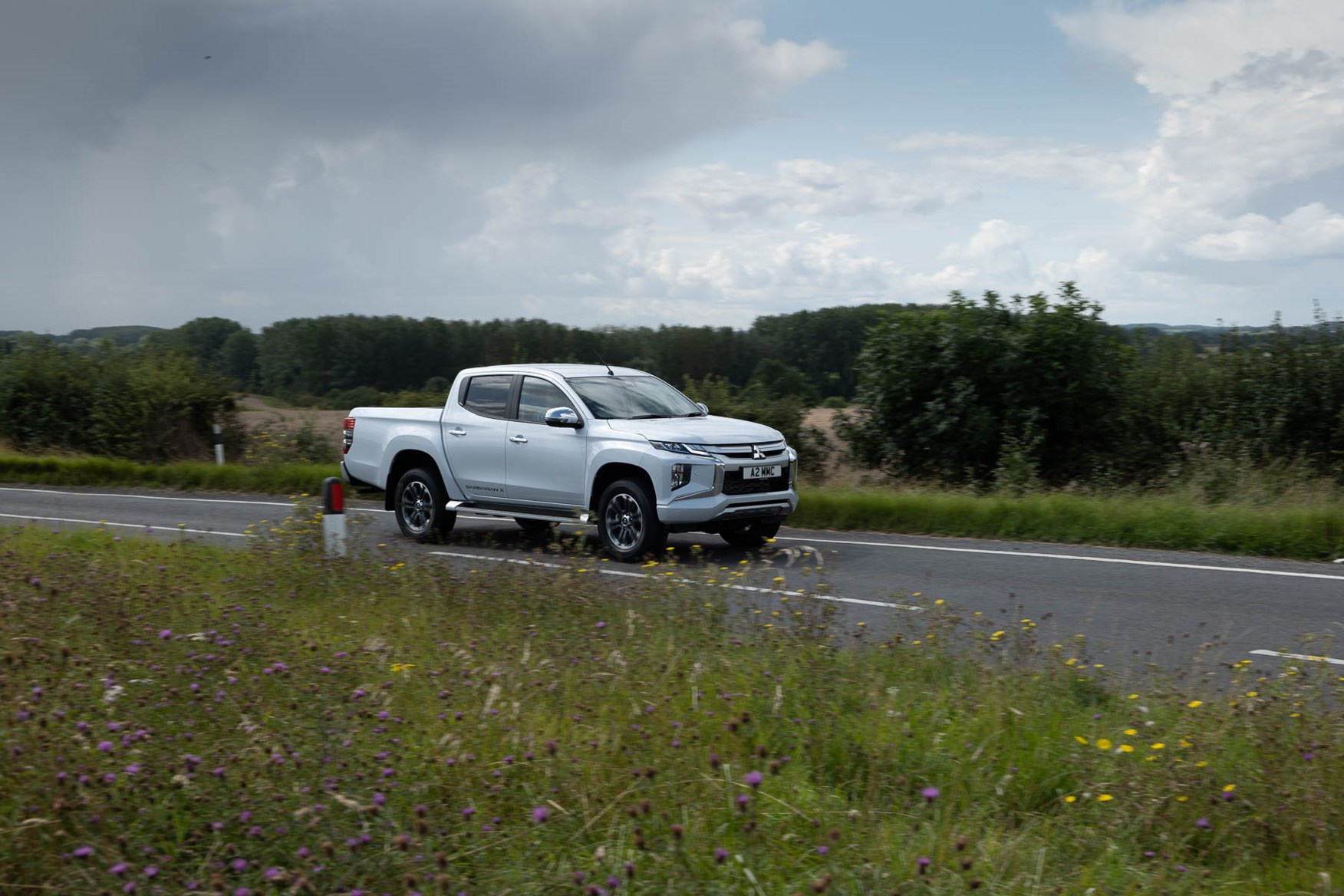 2019 Mitsubishi L200 pickup, driving. Barbarian X in Diamond White