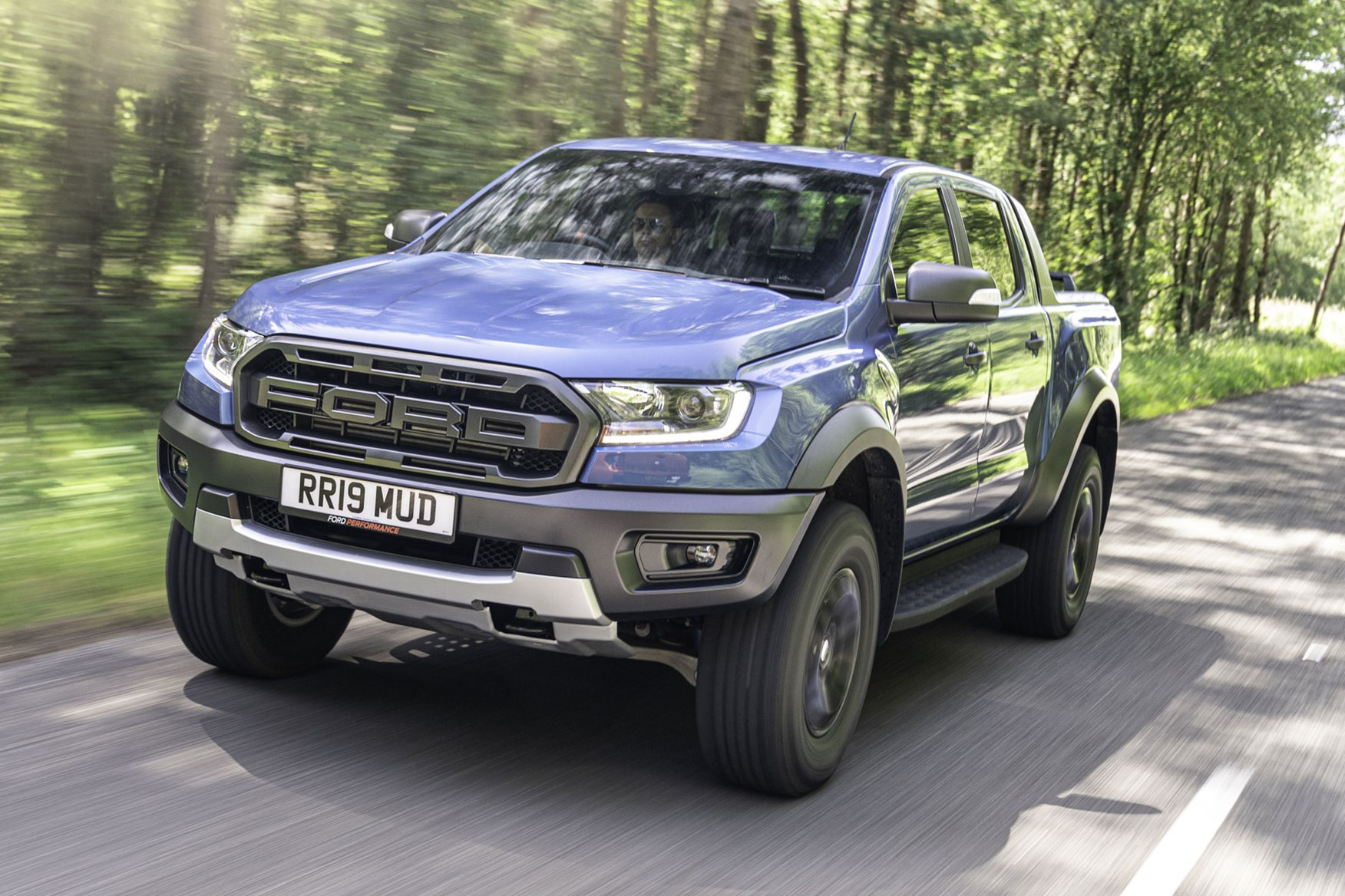 Ford Ranger Raptor review - front view, blue, driving on road, 2019