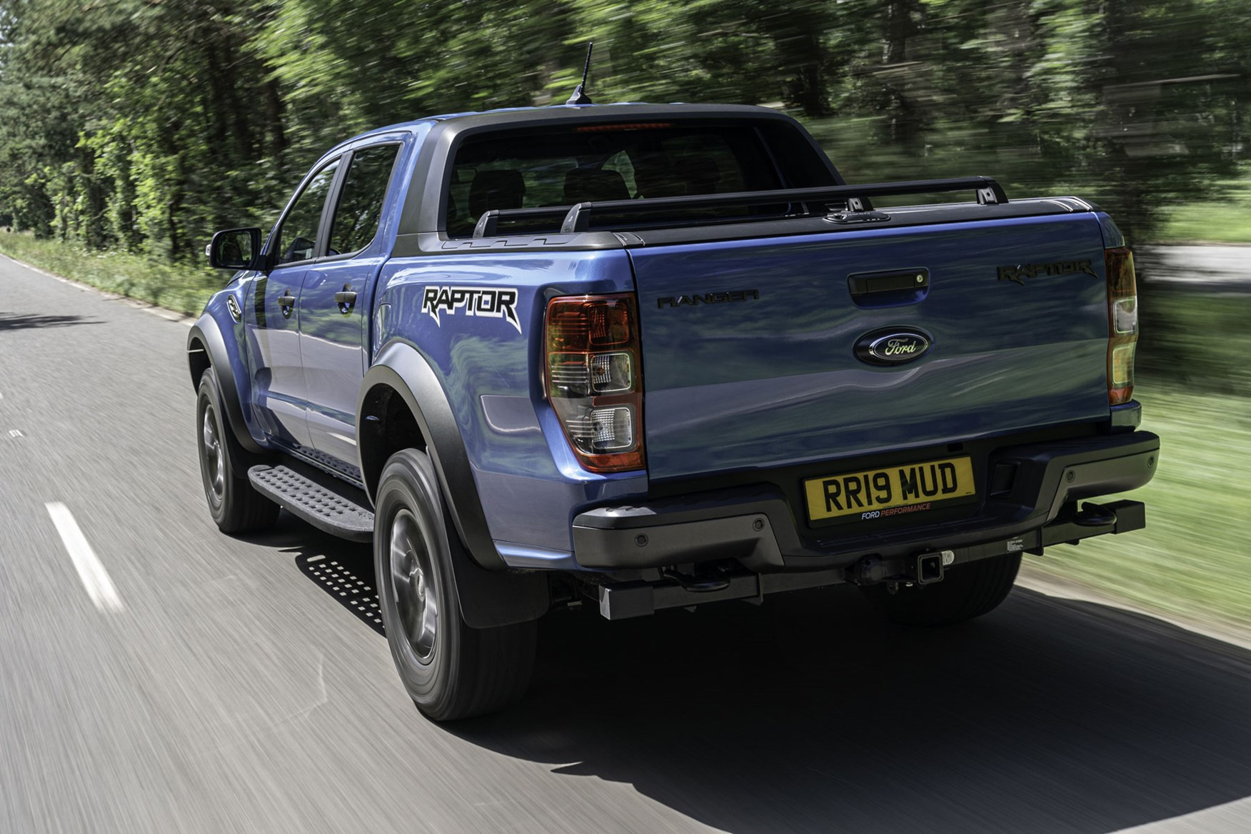 Ford Ranger Raptor review - rear view, blue, driving on road, 2019