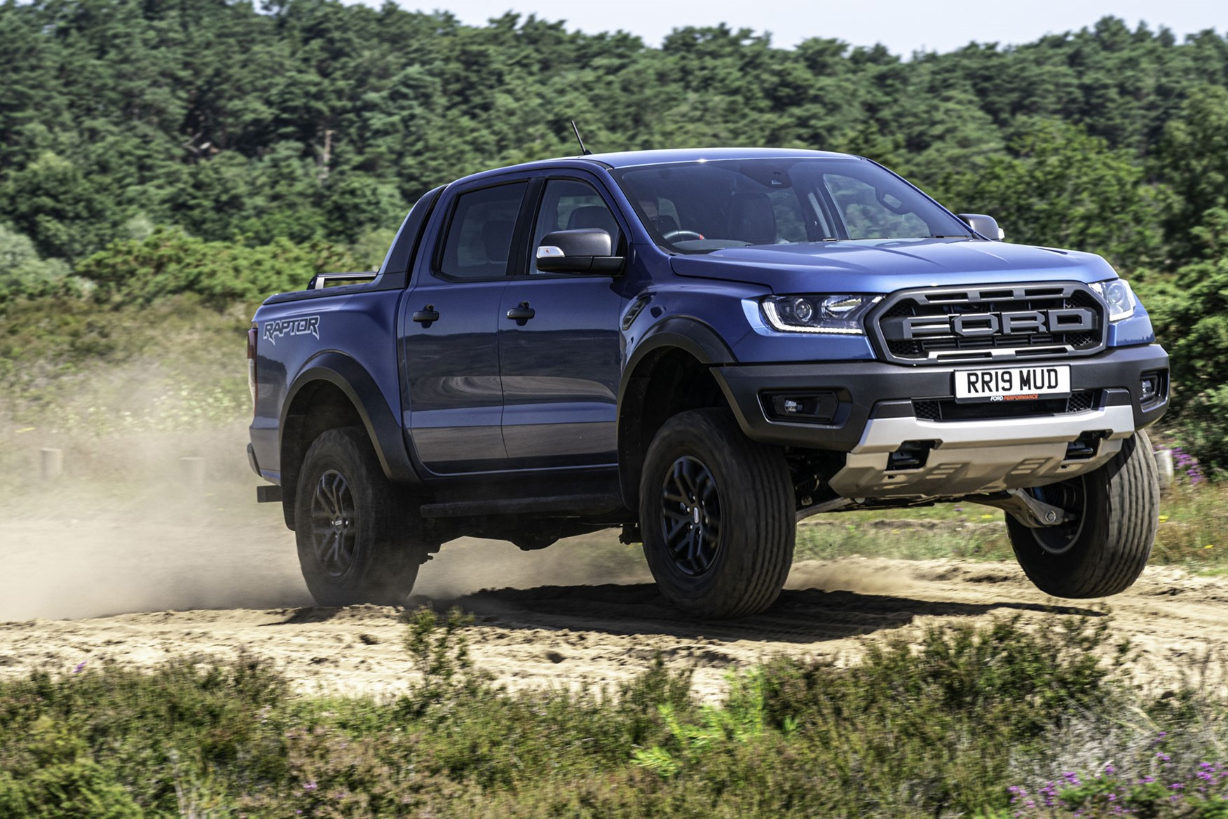 Ford Ranger Raptor review - front view, blue, jumping off road, 2019