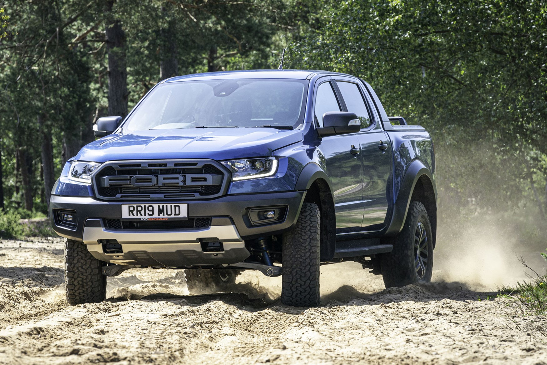 Ford Ranger Raptor review - front view, sliding sideways off road, 2019