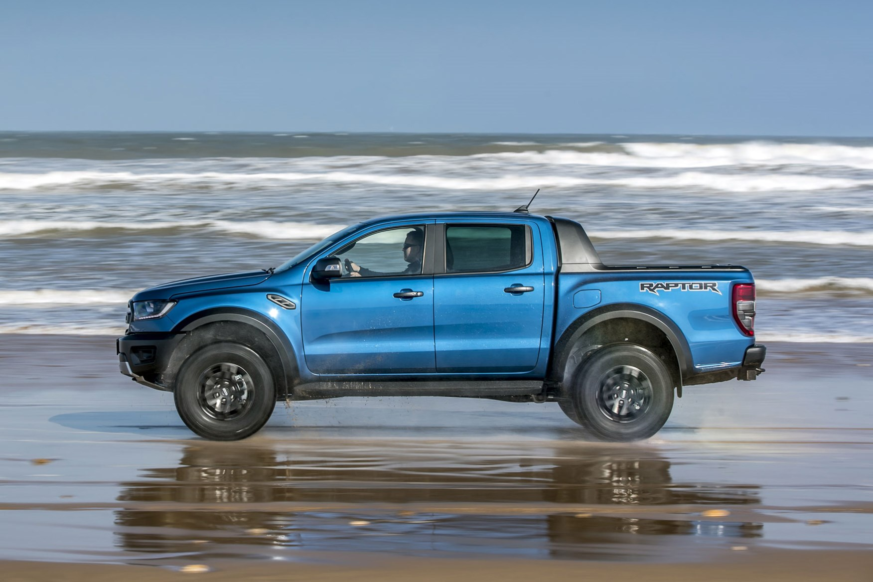 Ford Ranger Raptor review - side view, blue, on  beach in water, 2019