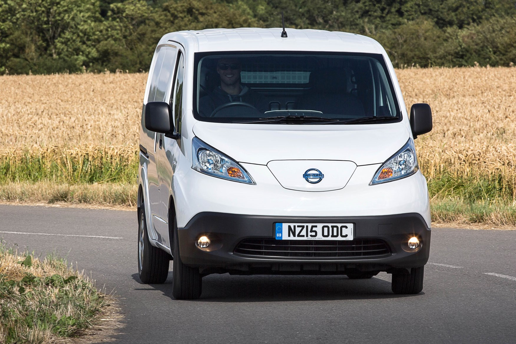 Nissan e-NV200 review, 2020, white, front view, driving round corner