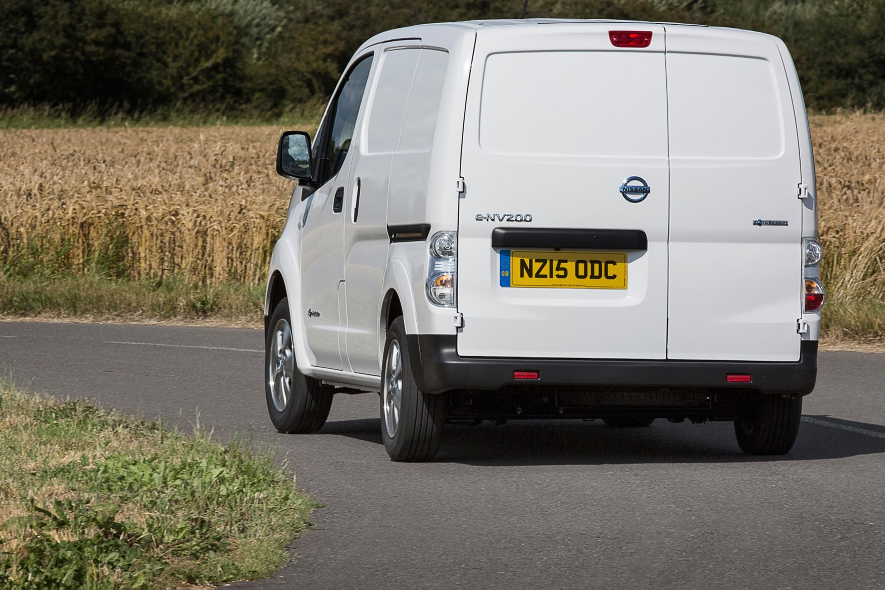Nissan e-NV200 review, 2020, white, rear view, driving round corner