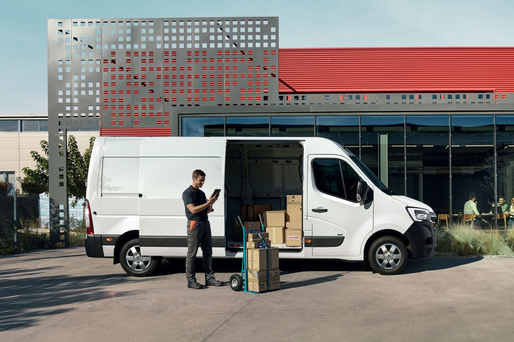 Renault Master ZE electric van review, 2020 - side view, being loaded