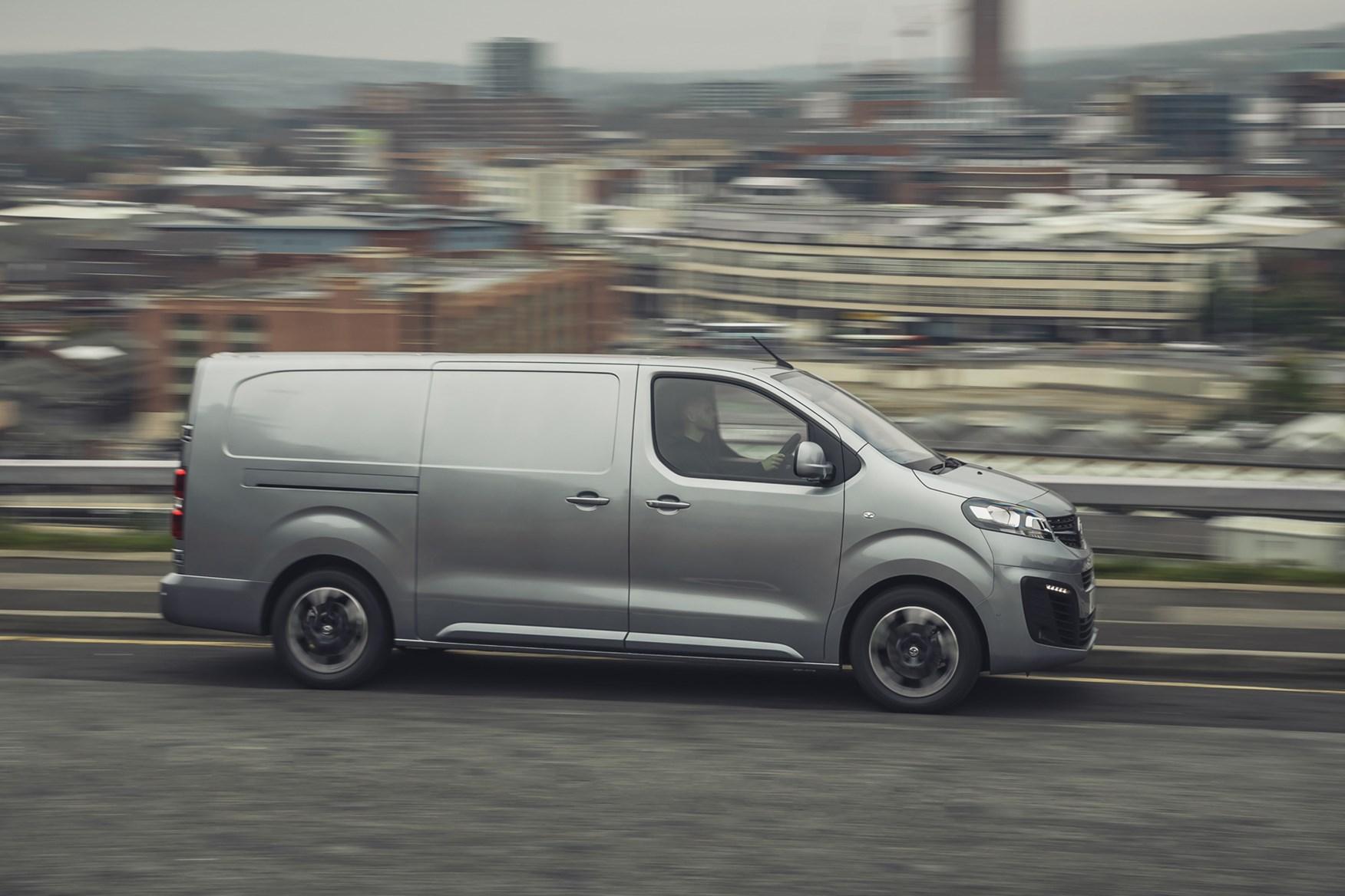 Vauxhall Vivaro-e review, 2020, electric van, side view, driving, grey