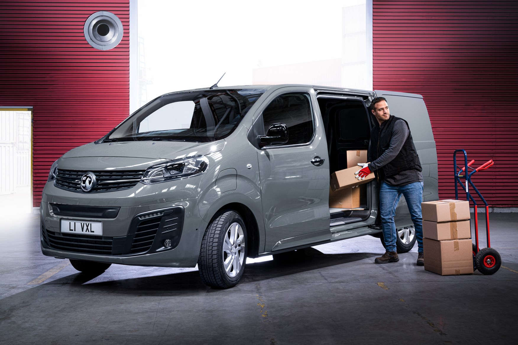 Vauxhall Vivaro-e review, 2020, electric van, front  view, being loaded, grey