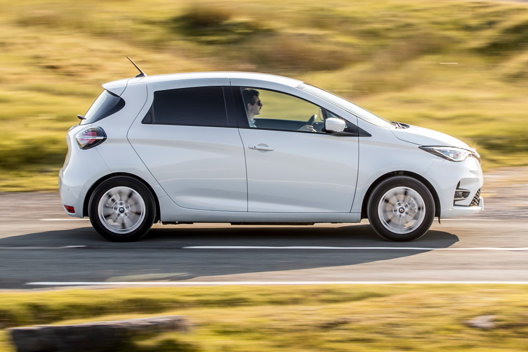 Renault Zoe Van review, 2020, side view, white, driving