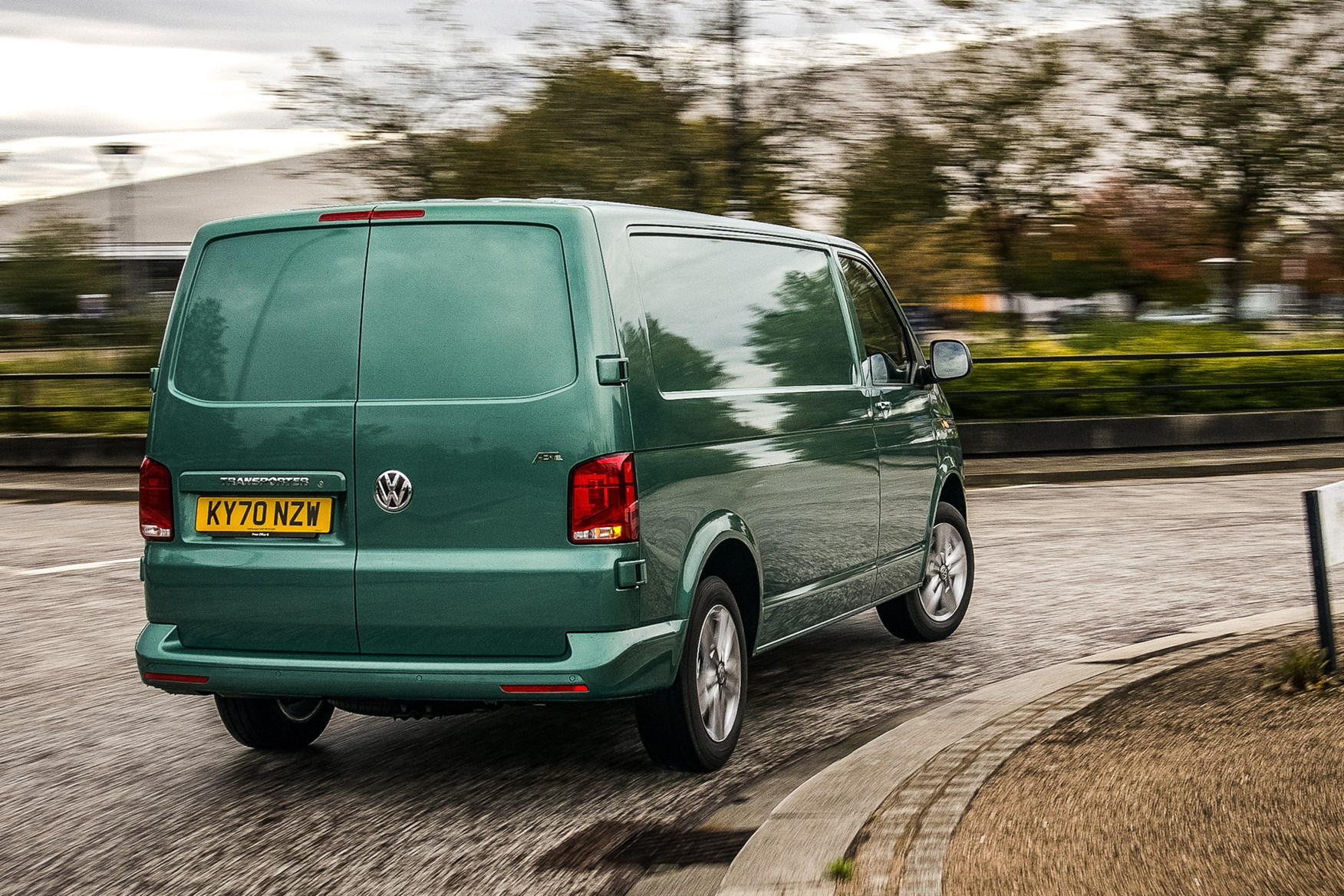 Volkswagen e-Transporter electric van review, 2020, rear view, driving round corner, green