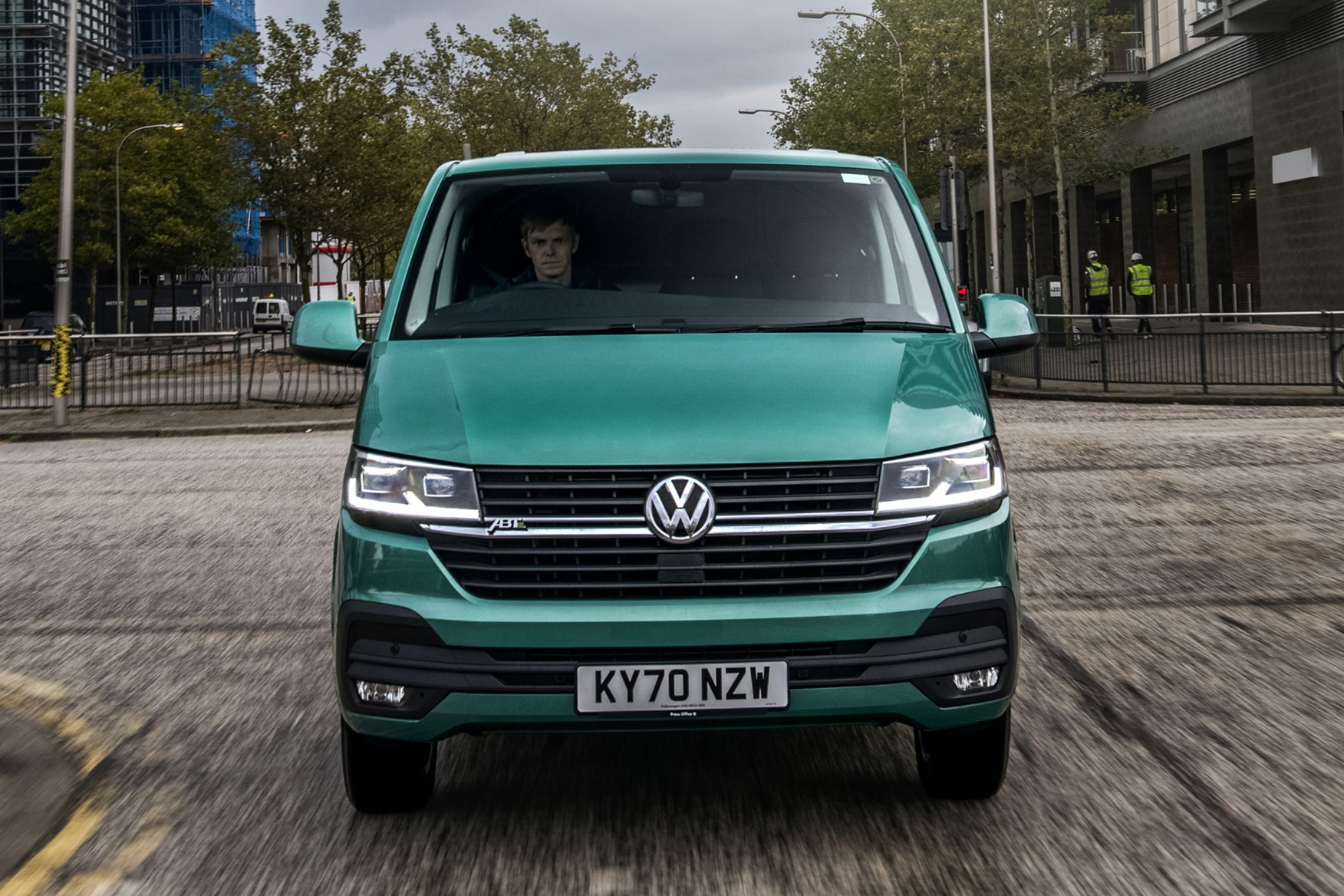 Volkswagen e-Transporter electric van review, 2020, dead-on front view, driving, green