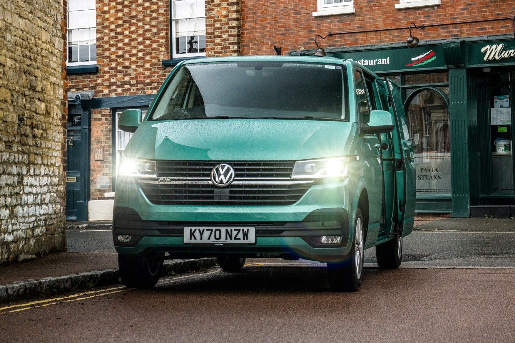 Volkswagen e-Transporter electric van review, 2020, front view, lights on, side door open, green