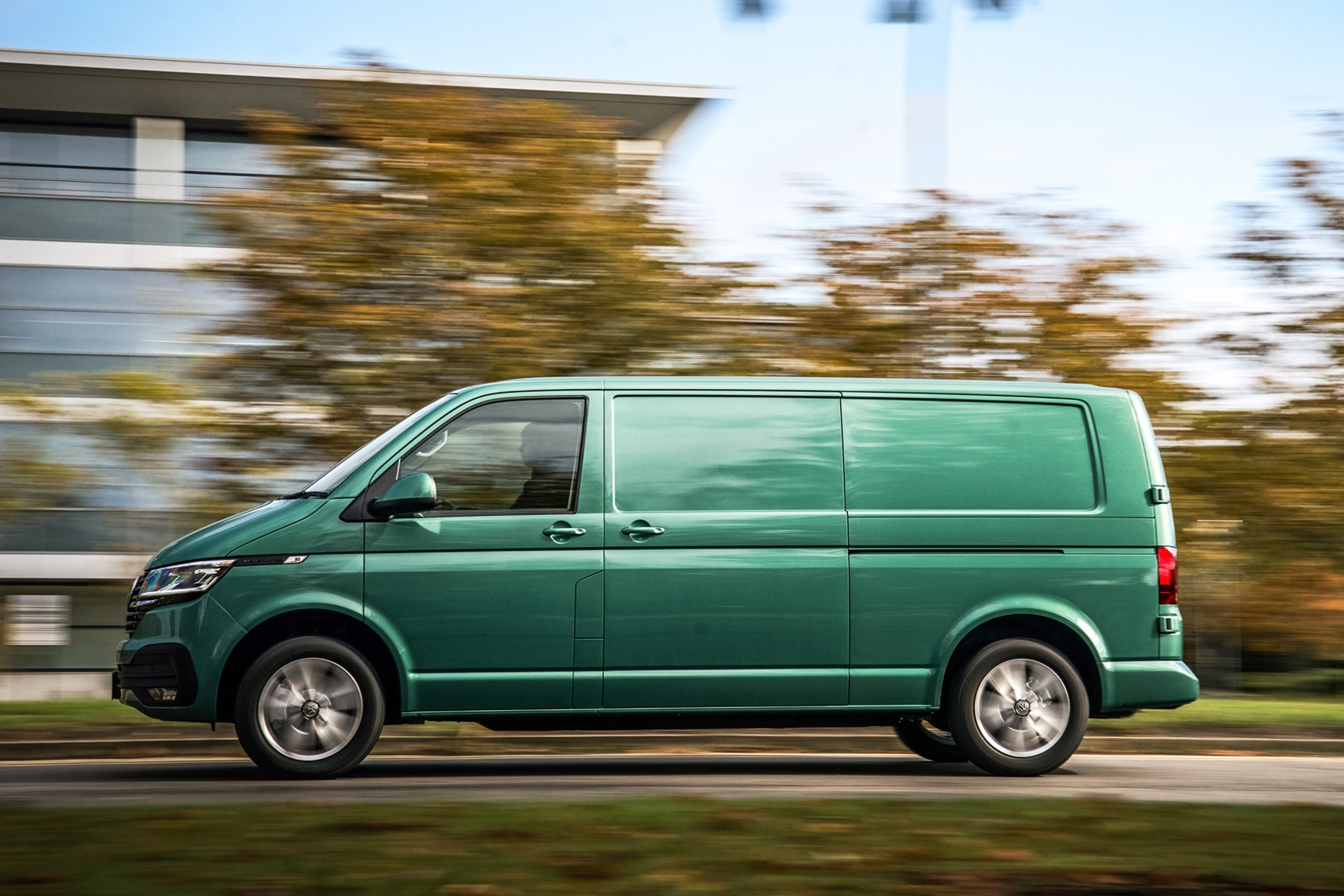 Volkswagen e-Transporter electric van review, 2020, passenger side, driving, green
