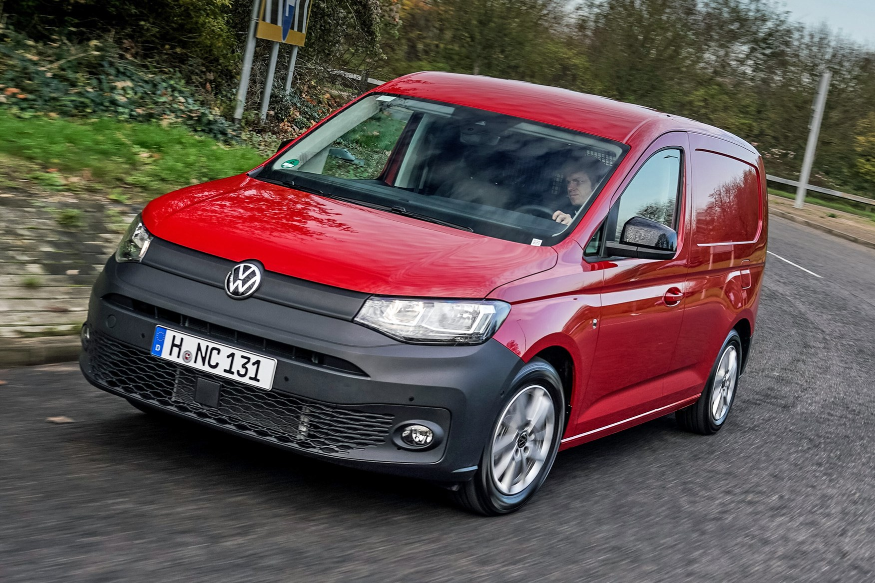 Volkswagen Caddy Cargo review, red, front view, driving round UK roundabout