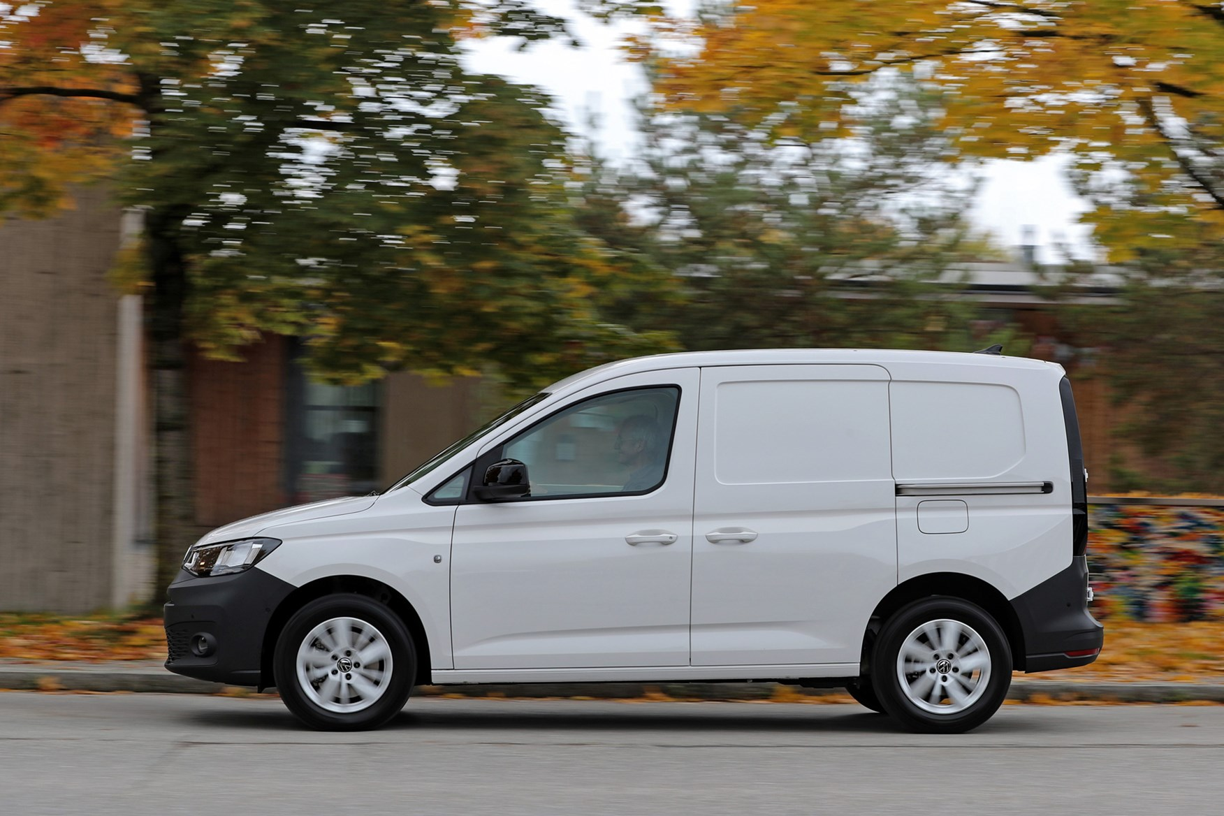 Volkswagen Caddy Cargo review, passenger side view, white, driving