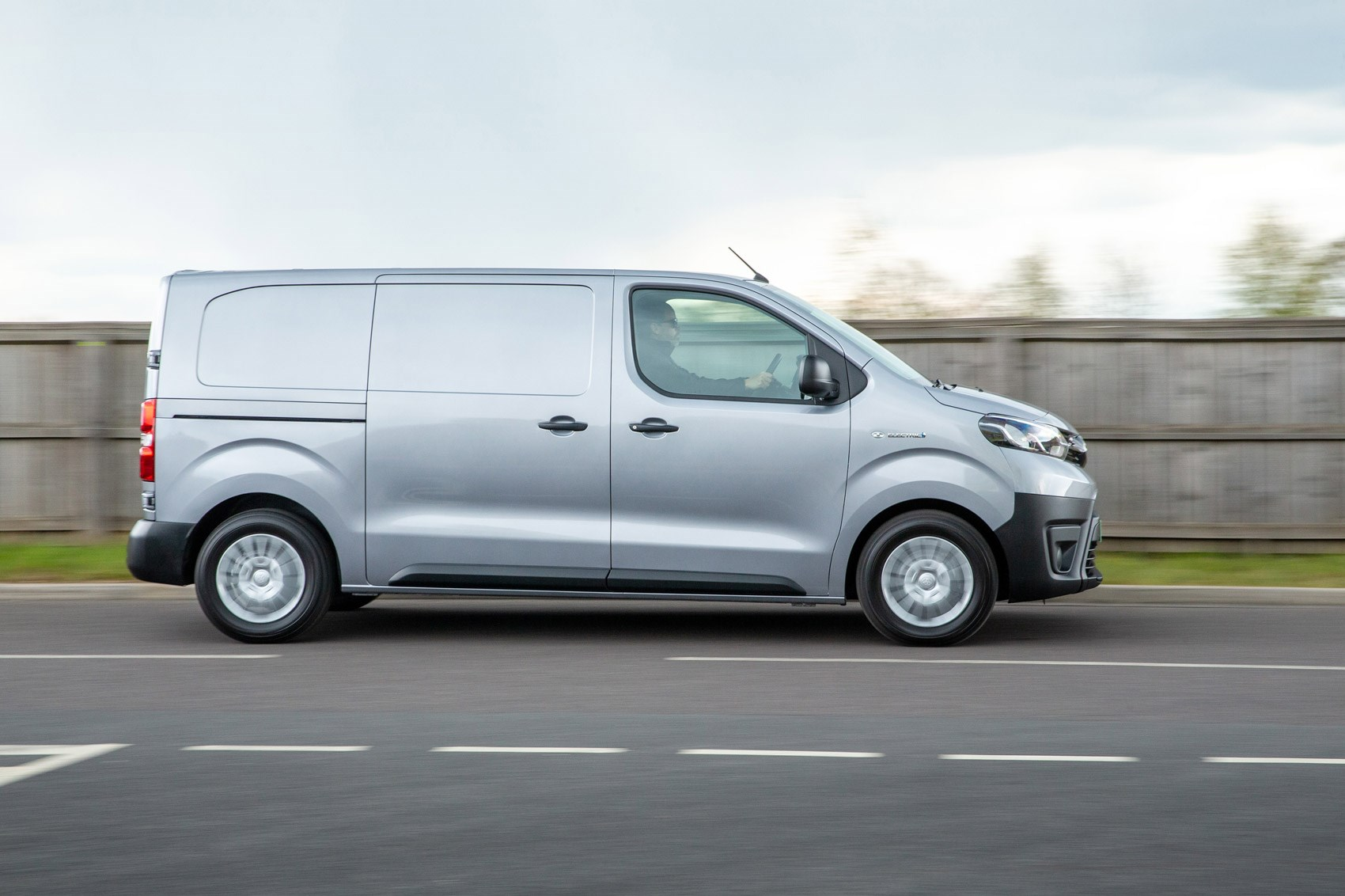 Toyota Proace Electric van review, side view, driving, silver