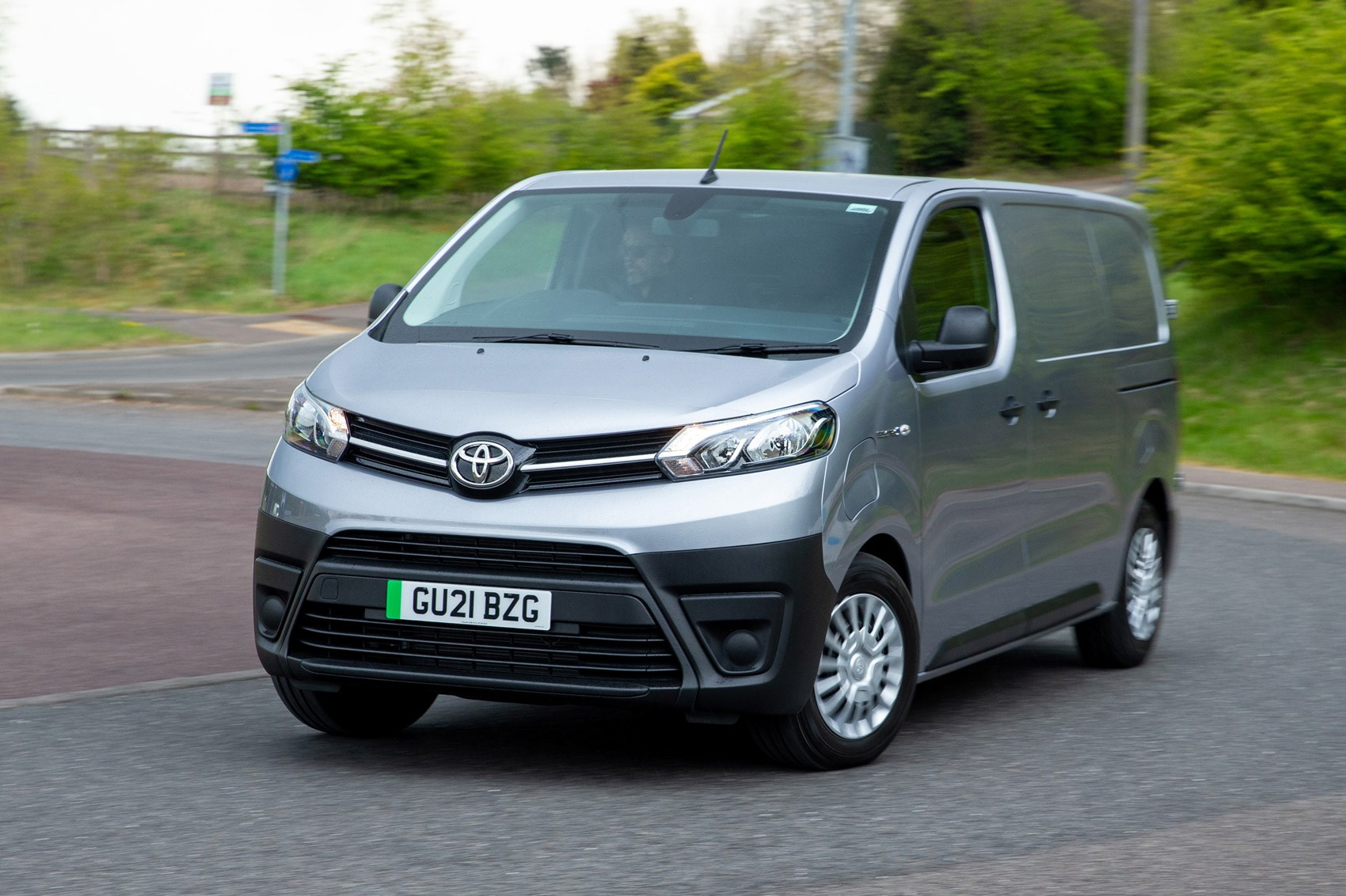 Toyota Proace Electric van review, front view, driving round corner, silver