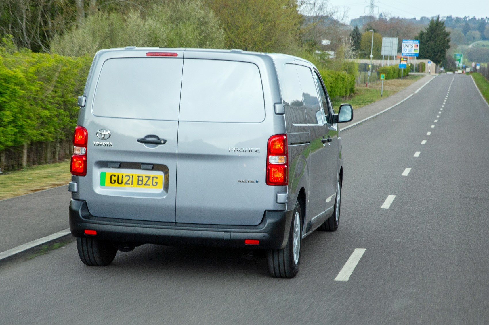 Toyota Proace Electric van review, rear view, driving, silver