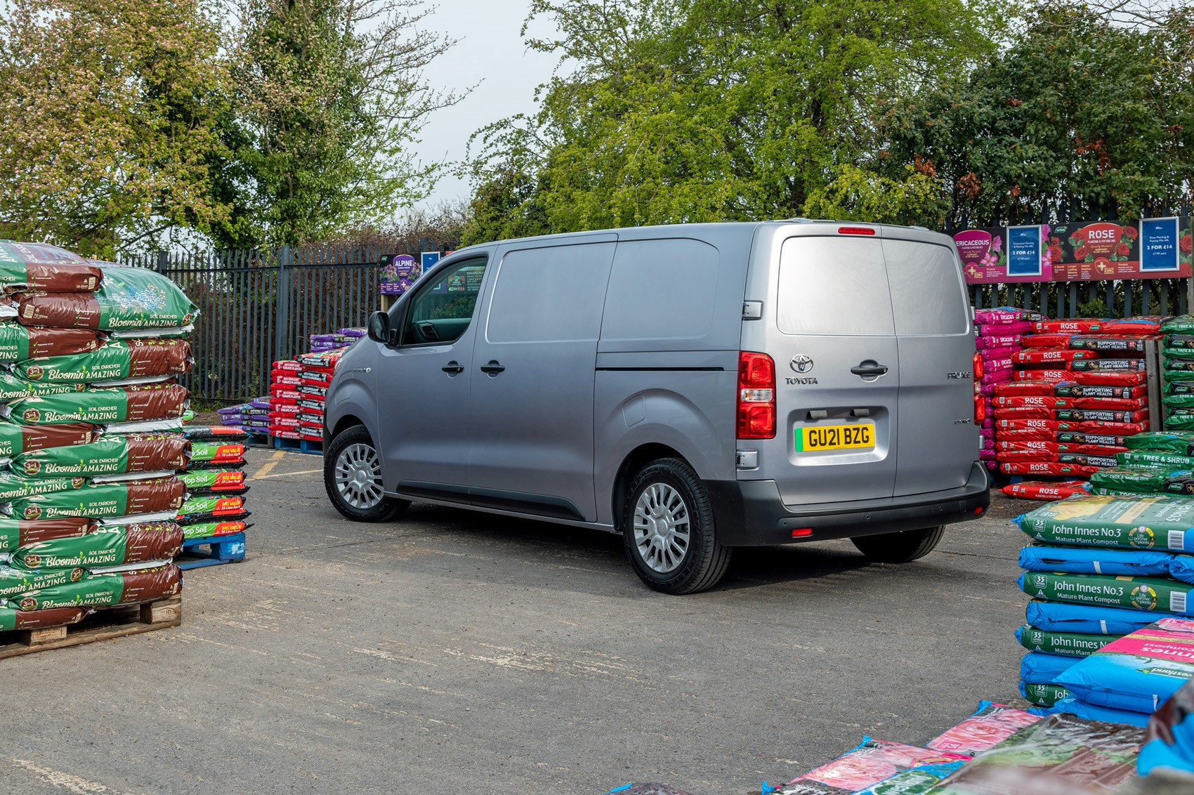Toyota Proace Electric van review, rear view, garden centre, silver